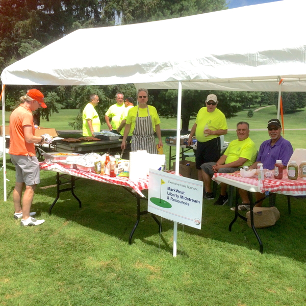volunteers serve lunch on the turn