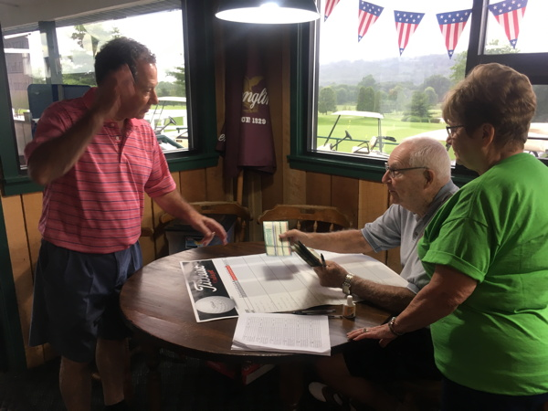 Coach Otto Pritchard & his wife Levina record scores to determine prize winners
